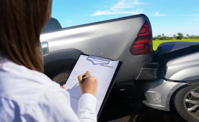 adjuster filling out form after a car accident