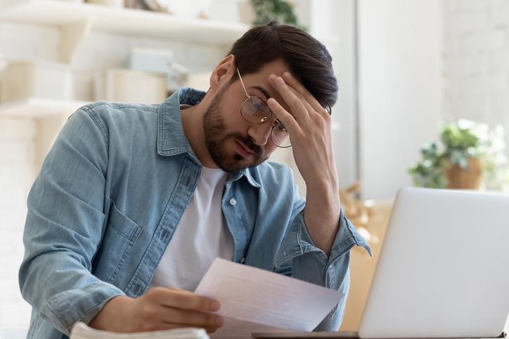 man looking at his insurance rates